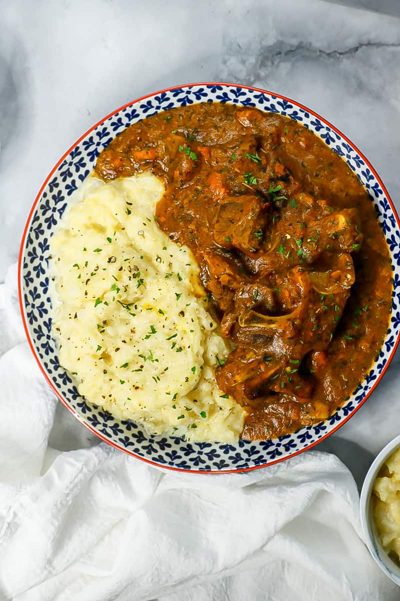 Stew with turnips mash in bowl