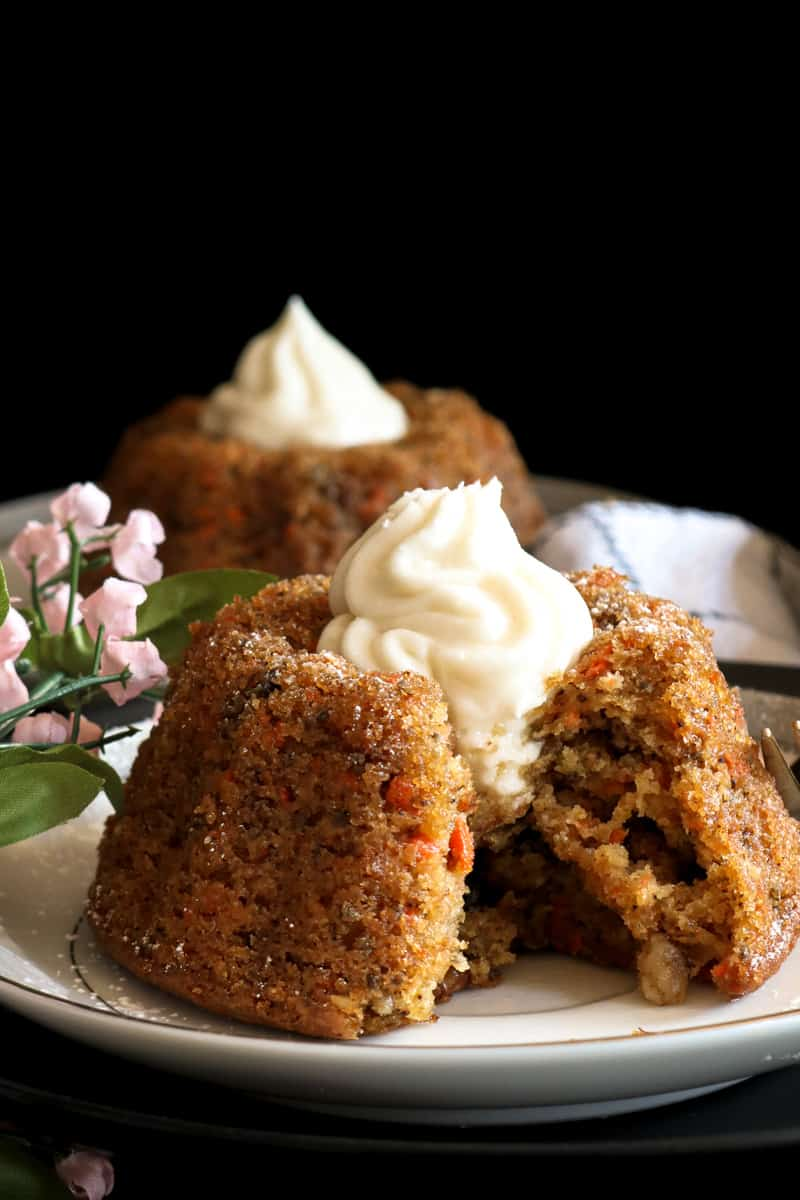 cutout dairy free carrot cake on white plate