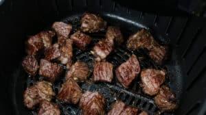 Steak bites in air fryer basket