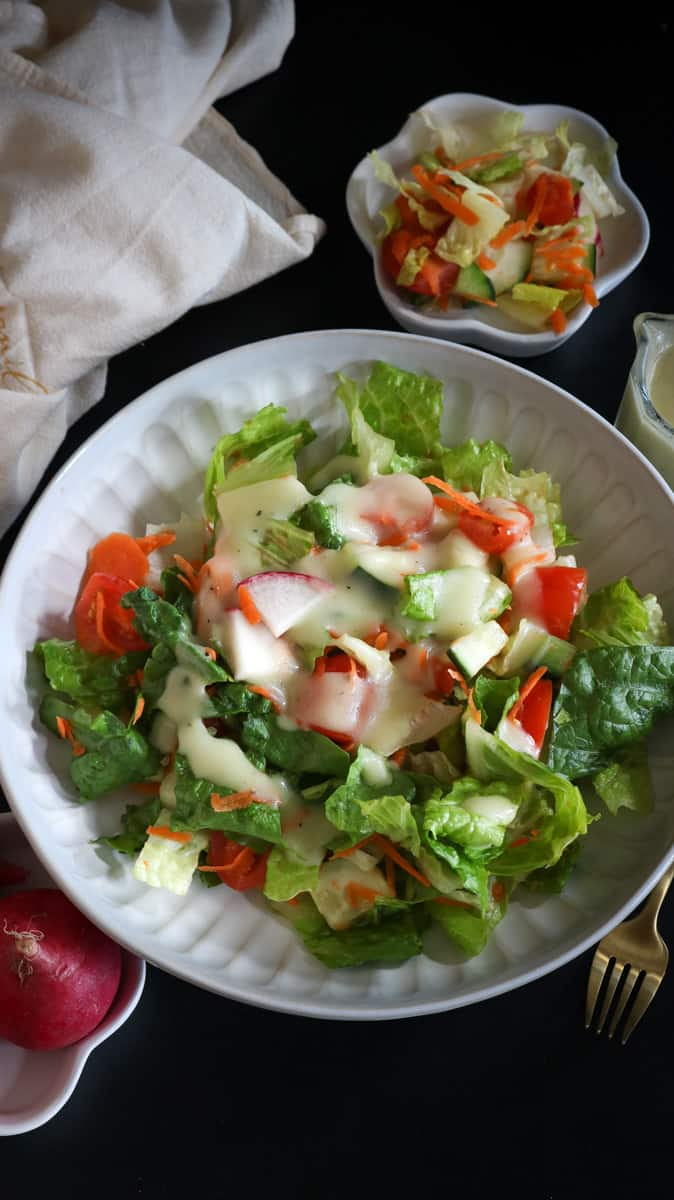 garden salad in white bowl