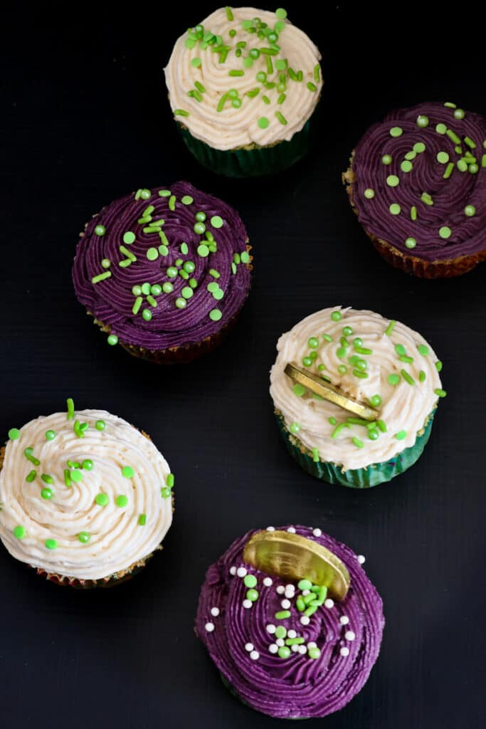 Irish cream cupcakes on black board with coins inserted