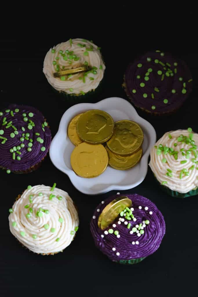 Irish cream cupcakes on black board with coins in the middle