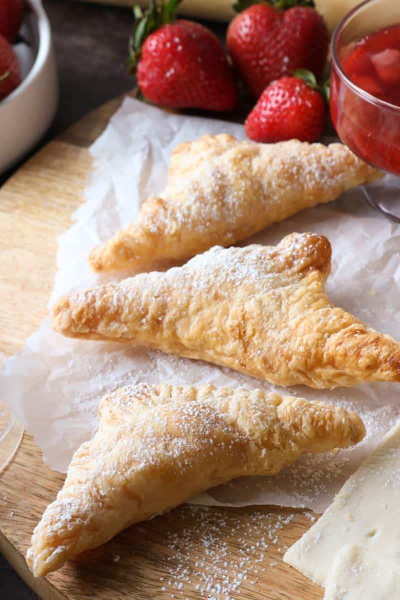 strawberry and strudel on cutting board