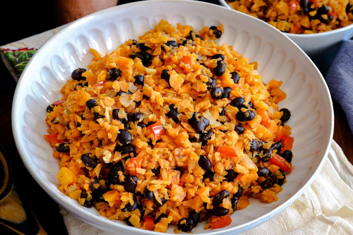closeup picture of rice and beans in white bowl