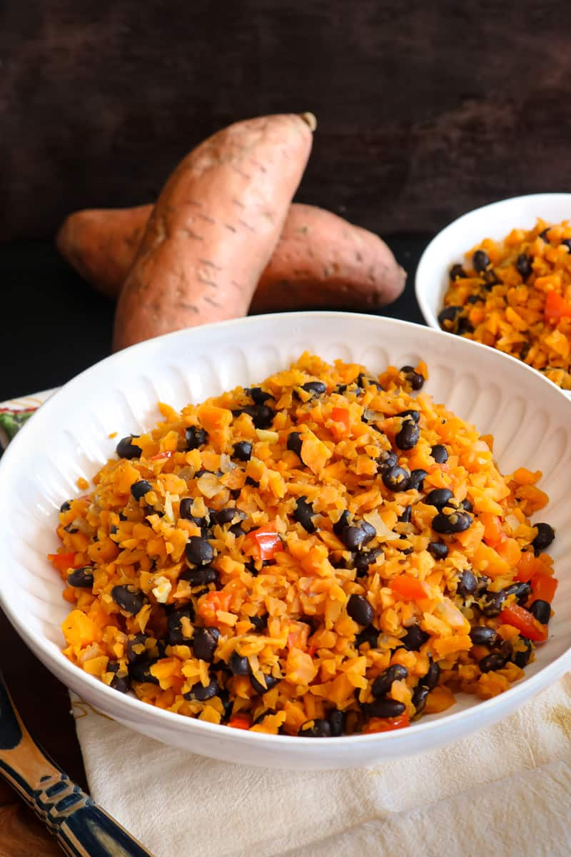 sweet potato rice in white bowl with black beans