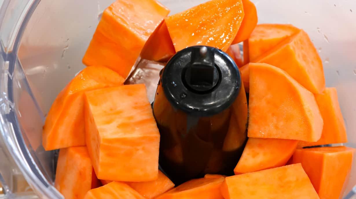 cubed sweet potatoes in food processor