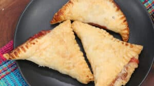 strawberry turnovers on black plate