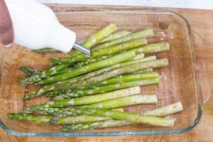 olive oil drizzled over asparagus