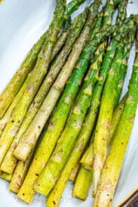 Cooked Air fryer asparagus in white bowl
