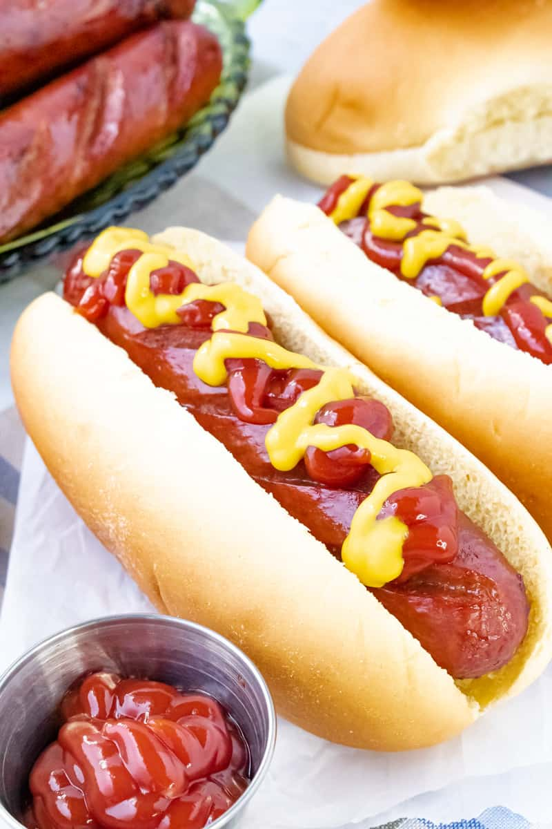 Beef franks topped with mustard and ketchup