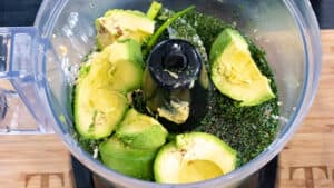 avocado and herbs in food processor