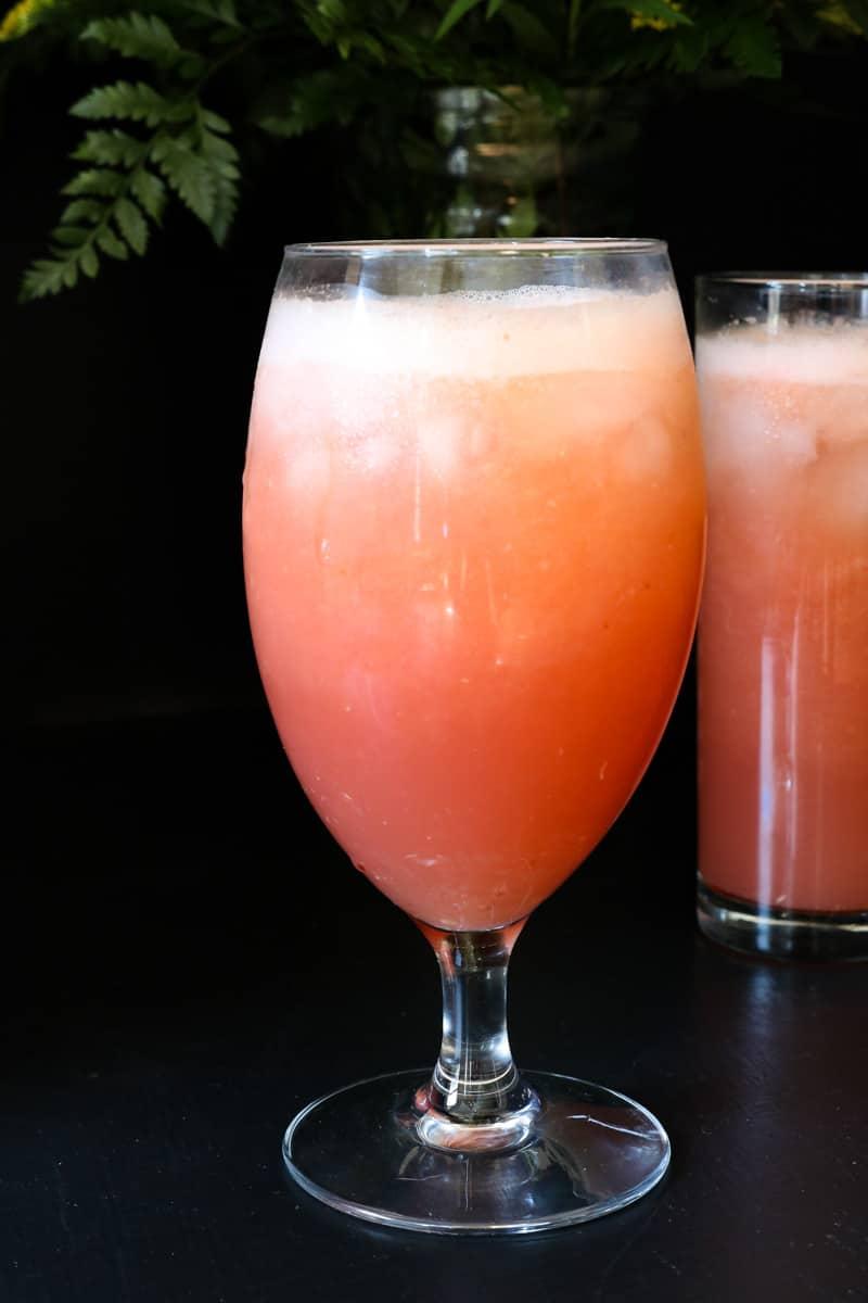 Grapefruit Juice in glass on blackboard