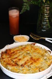 enchiladas in white baking dish