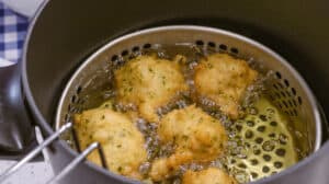 fritters in hot oil deep frying pan