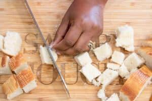 cutting bread on board