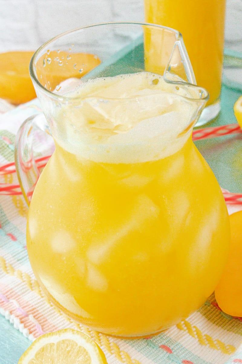 Mango lemonade in glass pitcher