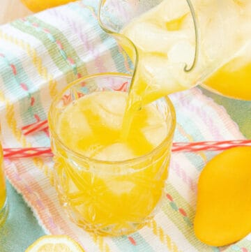 Mango lemonade being poured in glass