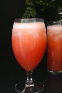 two glasses of grapefruit juice on blackboard