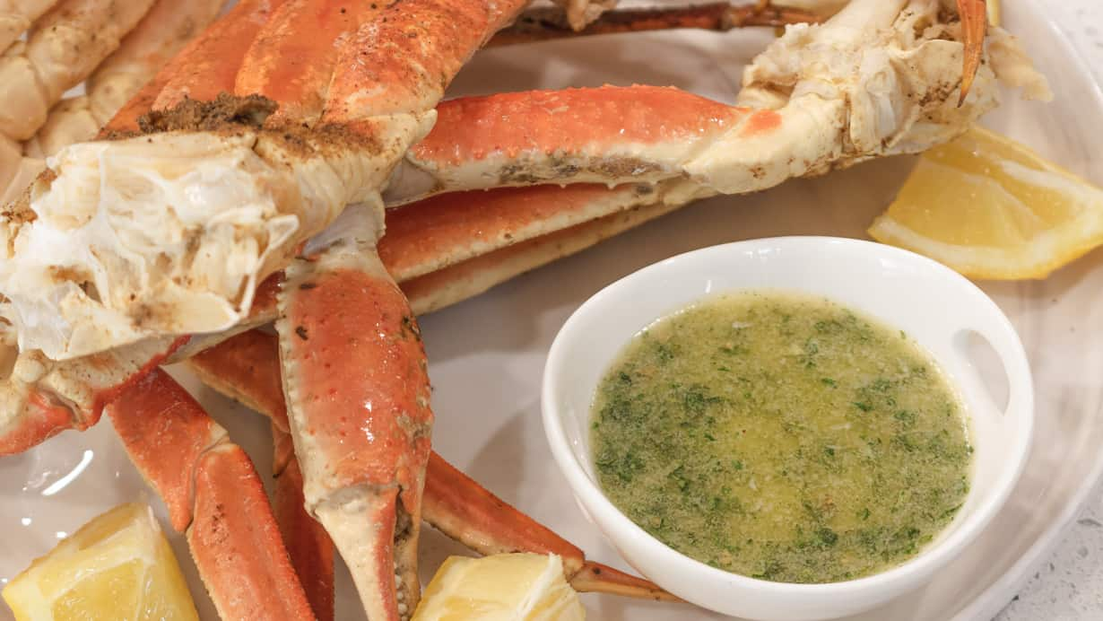 instant pot crab legs on white plate with lemon wedges