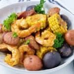 instant pot shrimp boil in white plate
