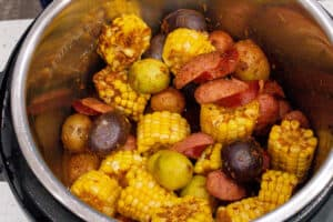cooked sausage, corn, and potatoes in instant pot