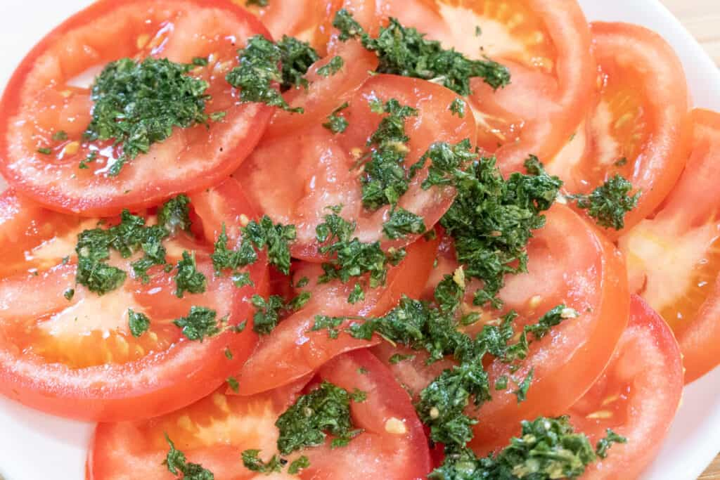 tomatoes topped with herbs