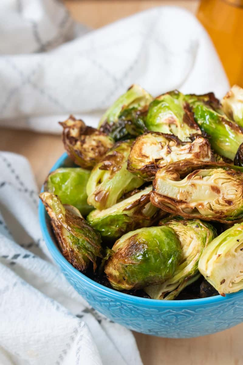 Crispy Air Fryer Brussels Sprouts in blue bowl
