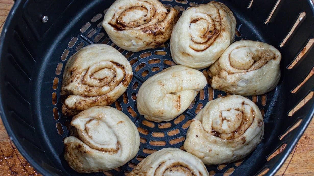 cinnamon rolls placed in the air fryer basket