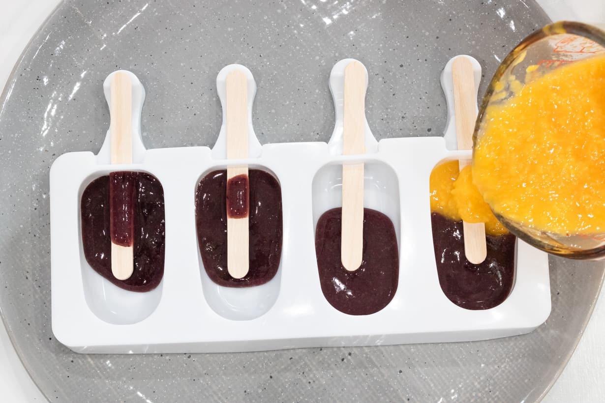 mango puree added to blueberry molds