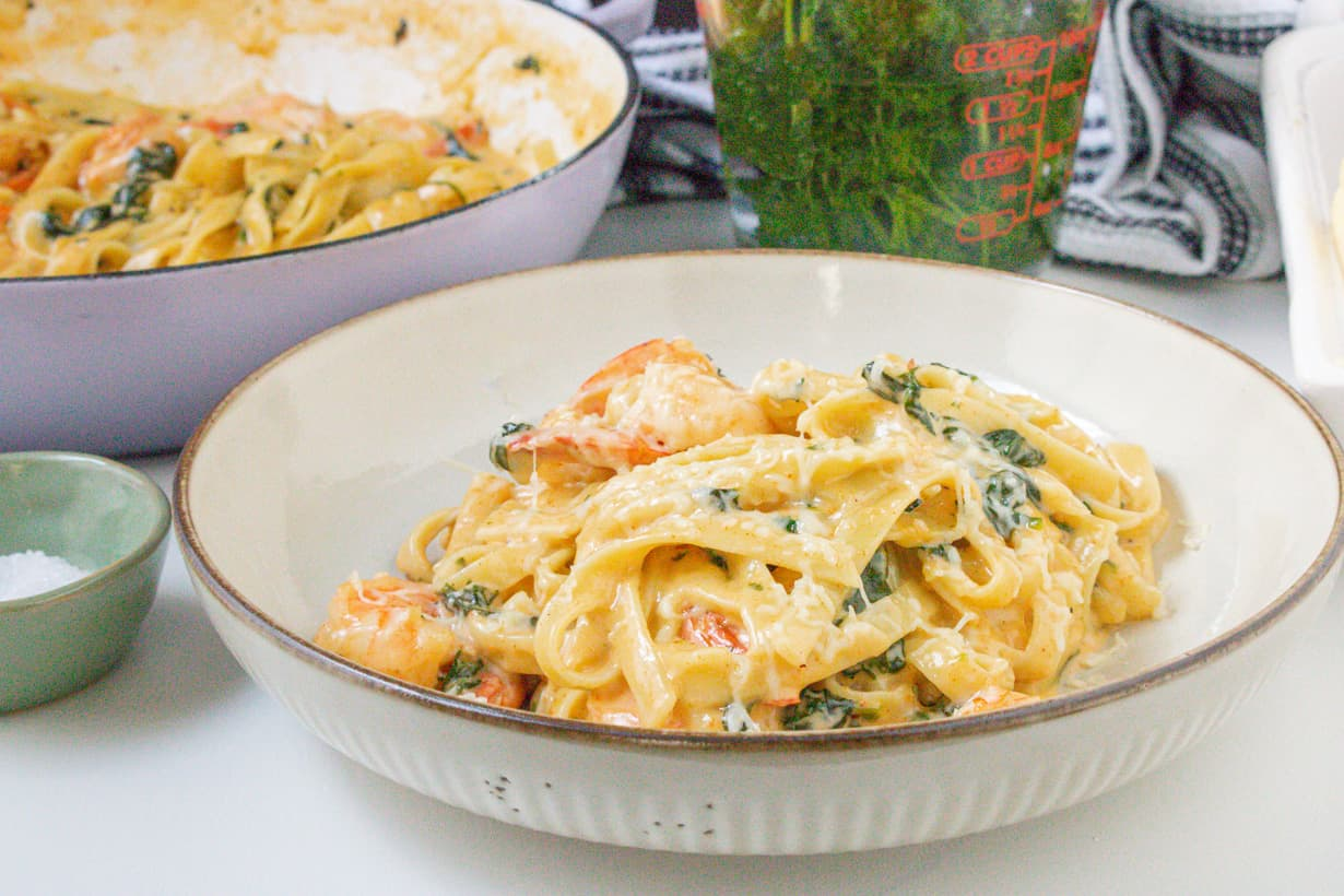 shrimp and spinach Alfredo on plate