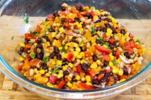 ingredients in a large bowl to make salsa bean dip