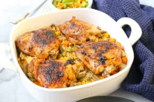 cooked chicken and rice in white baking dish