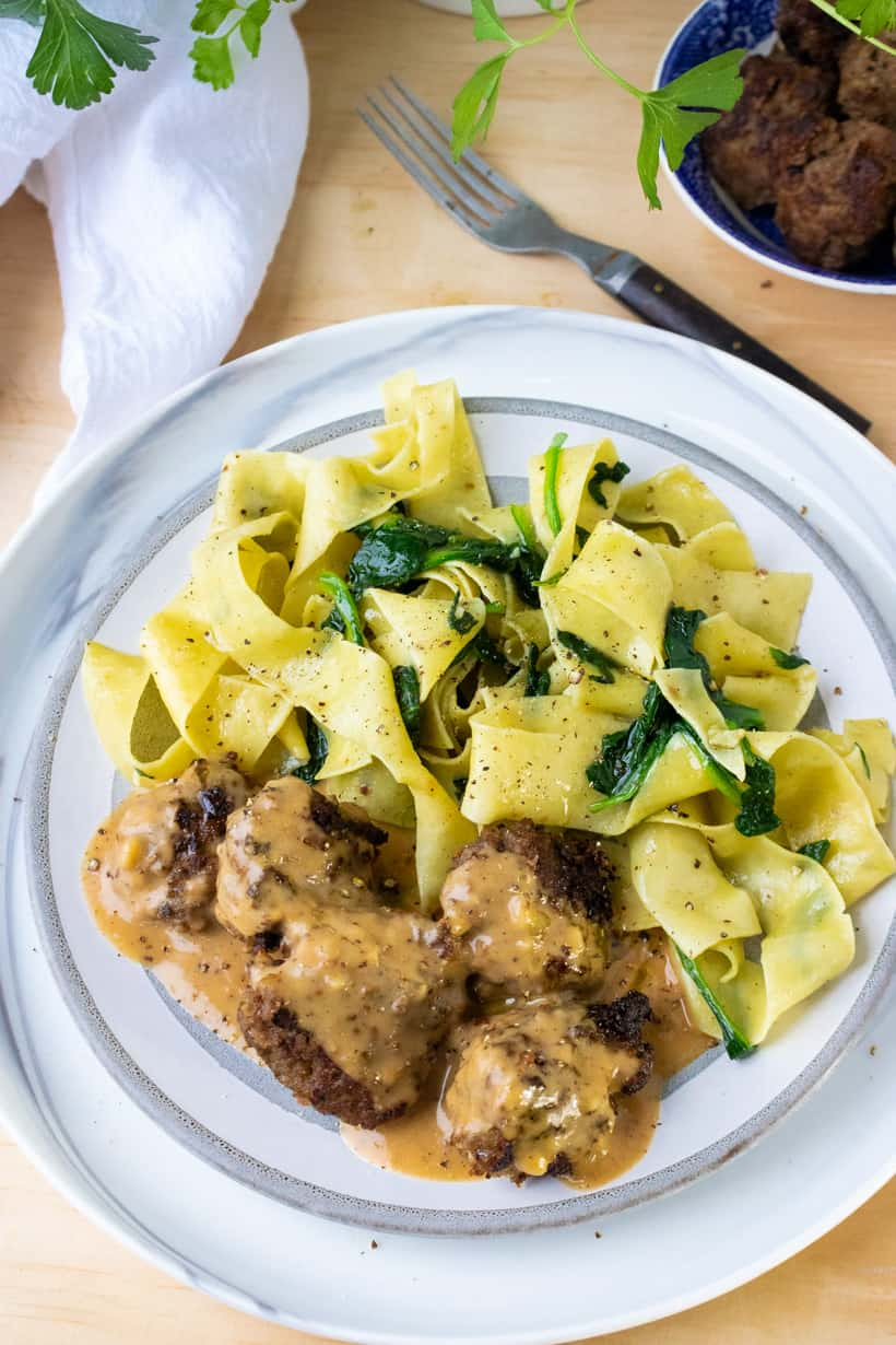 Swedish meatballs with noodles on white plate